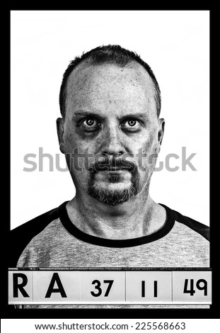 Mug shot, A fake set up booking photograph, black eye and dirty skin black and white version - stock photo