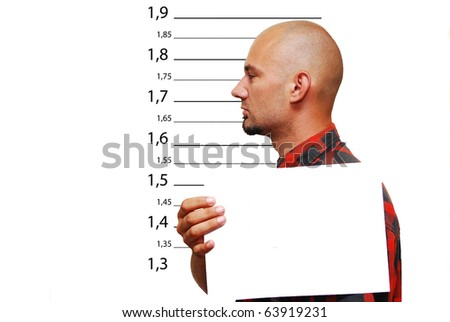 Mug shot of a young skinhead  hispanic - stock photo