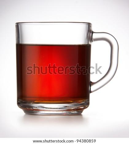 Mug with black tea on white background - stock photo