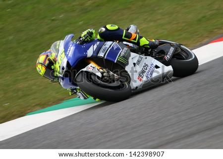 MUGELLO - ITALY, MAY 31: Italian Yamaha rider Valentino Rossi at 2013 TIM MotoGP of Italy at Mugello circuit on May 31, 2013 - stock photo