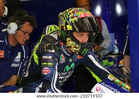 MUGELLO - ITALY, MAY 31: Italian Yamaha rider Valentino Rossi at 2014 TIM MotoGP of Italy at Mugello circuit on May 31, 2014 - stock photo