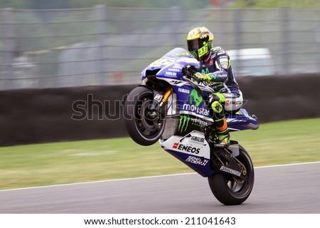 MUGELLO - ITALY, MAY 30: Italian Yamaha rider Valentino Rossi at 2014 TIM MotoGP of Italy at Mugello circuit on May 30, 2014 - stock photo