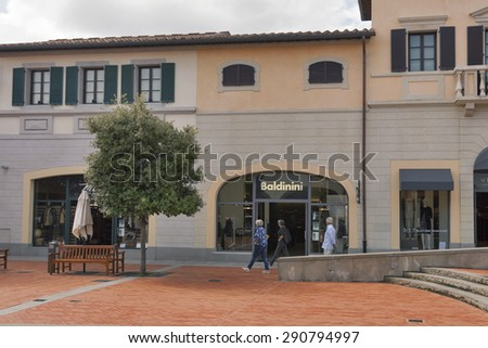MUGELLO, ITALY - SEPTEMBER 11, 2014: People walk along Baldinini store in McArthurGlen Designer Outlet Barberino. Baldinini is an italian footwear manufacturer founded by San Mauro Pascoli in 1910. - stock photo