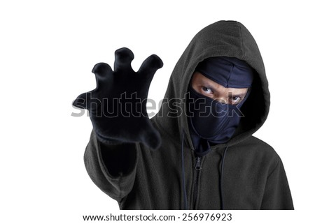 Mugger with mask and hoodie showing his hand to steal something, isolated on white - stock photo