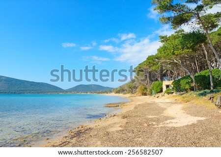 Mugoni beach on a clear spring day. Shot in Alghero, Italy - stock photo