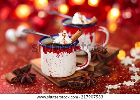 Mugs with hot chocolate for Christmas day.  - stock photo