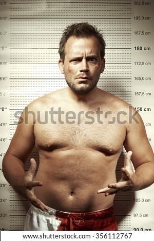 Mugshot photo of evil man - stock photo