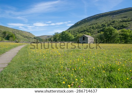 Muker barn and Hay meadows in the Yorkshire Dales - stock photo
