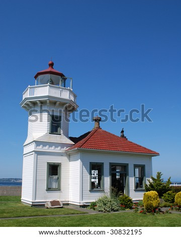 Mukilteo Lighthouse Built in 1906 at the Site Where in 1792 Captain George Vancouver Came Ashore to Survey While Exploring Puget Sound, Mukilteo, Washington, USA - stock photo