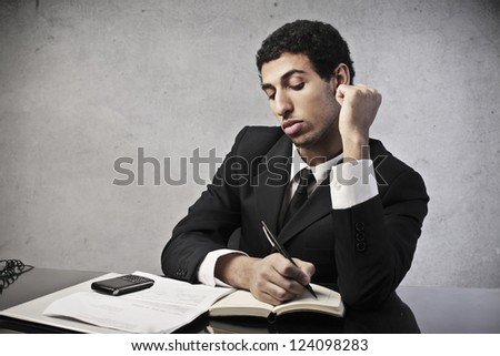 Mulatto businessman calculating some operations - stock photo