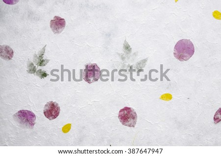 Mulberry paper texture with flower petals and leaves, natural handmade. - stock photo