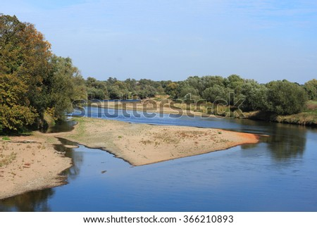 Mulde river in autumn in Saxony-Anhalt / Germany - stock photo