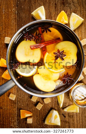 Mulled cider in a pot - stock photo