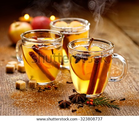 Mulled cider with cinnamon, anise, cloves and citrus - stock photo