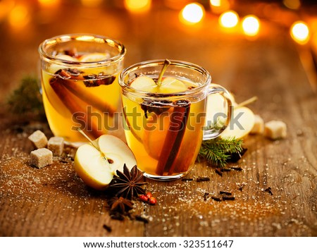 Mulled cider with cinnamon, cloves, anise and citrus - stock photo
