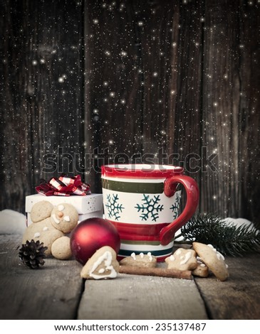 Mulled wine, gingerbread and Christmas decorations on vintage wooden table - stock photo