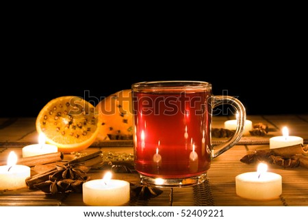 Mulled wine lit by candle light - stock photo