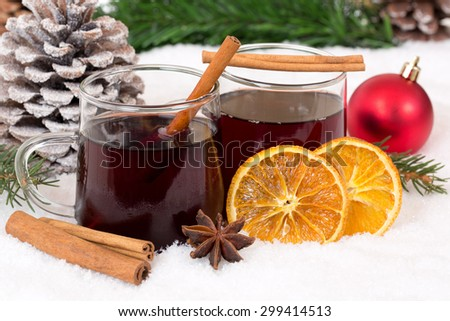 Mulled wine on Christmas in winter drinking alcohol drink decoration with snow - stock photo