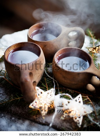 Mulled wine served from kuksa, specially made wooden cup - stock photo