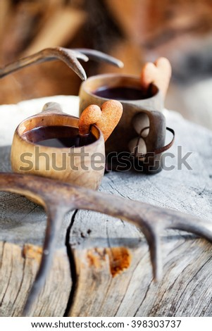 Mulled wine served from wooden cup, kuksa - stock photo