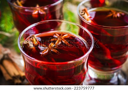 Mulled wine with cinnamon and anise, selective focus - stock photo