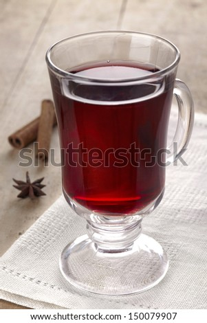 Mulled wine with cinnamon sticks and anise - stock photo