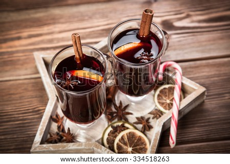 Mulled wine with cinnamon sticks and orange - stock photo