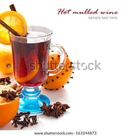 Mulled wine with slice of orange and spice. Christmas background - stock photo