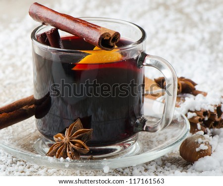 mulled wine with spices  and orange on a wooden table - stock photo