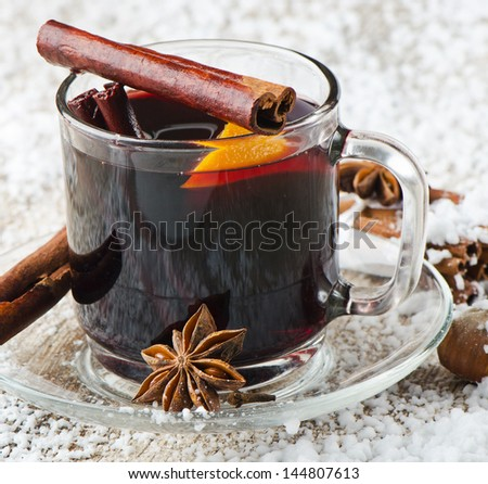 Mulled wine with spices and orange .Selective focus - stock photo