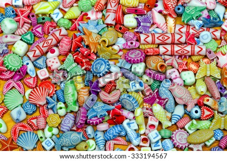 Multi Color Plastic Beads Variety Assortment Background - stock photo