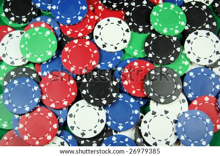 Multi color poker chip great for background art. - stock photo