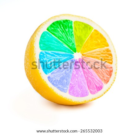 Multi color vitamins diversity concept - lemon cut half slice with color wheel rainbow colors isolated on white background - stock photo