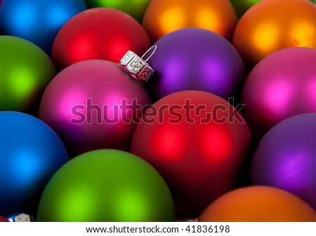 Multi-colored Christmas ornaments/baubles including pink, red, orange, blue, purple and green as a background - stock photo