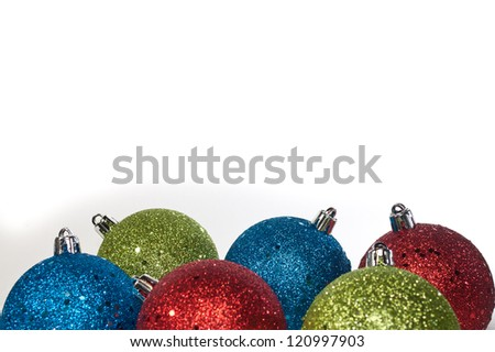 multi colored ornaments on a white background - stock photo