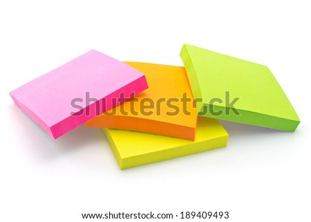 Multi-colored paper for notes, memos and reminders - stock photo