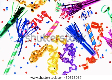 Multi-colored party favors shown on a white surface - stock photo