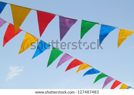 Multi Colored Triangular Flags Hanging in the Sky at an Outdoor Celebration Party. - stock photo