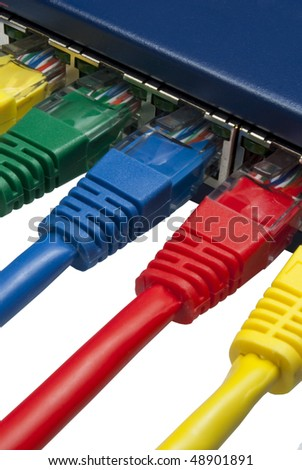 Multi coloured ethernet network plugs connected to a router / switch on isolated white background - stock photo
