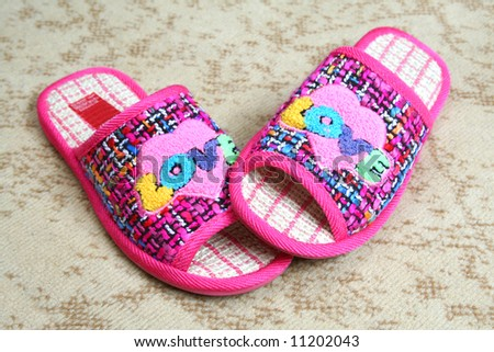 Multi-coloured slippers with heart - stock photo