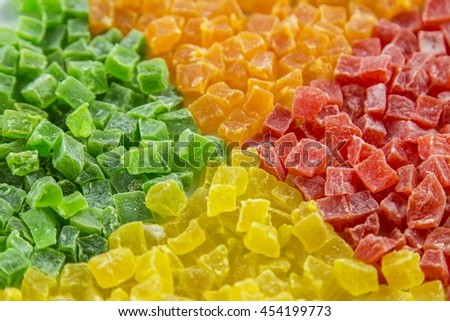 Multi coloured sweet candied dried fruits, background - stock photo