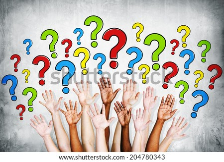 Multi-ethinic arms outstretched to ask questions. - stock photo