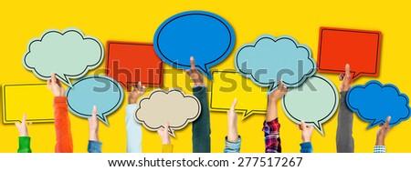 Multi-ethnic Arm Raised Unity Togetherness Speech Bubbles Concept - stock photo
