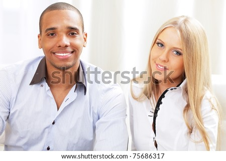 Multi ethnic business couple on a meeting - stock photo
