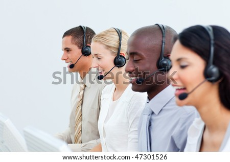 Multi-ethnic business people working in a call center in the office - stock photo