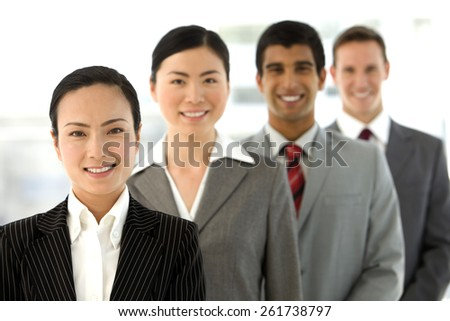 Multi ethnic business team standing in a row.  Selective focus. - stock photo