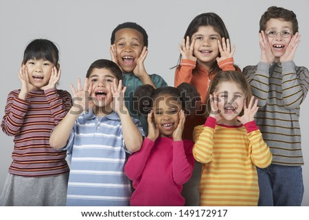 Multi-ethnic children yelling - stock photo