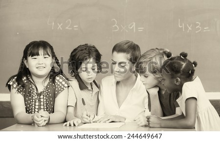 Multi ethnic classroom with teacher explaining mathematics lesson. - stock photo