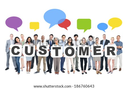 Multi-Ethnic Group Of Business And Casual People Holding Cardboards Forming Customer And Related Symbols Above - stock photo