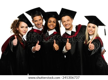 Multi ethnic group of graduated young students isolated on white - stock photo